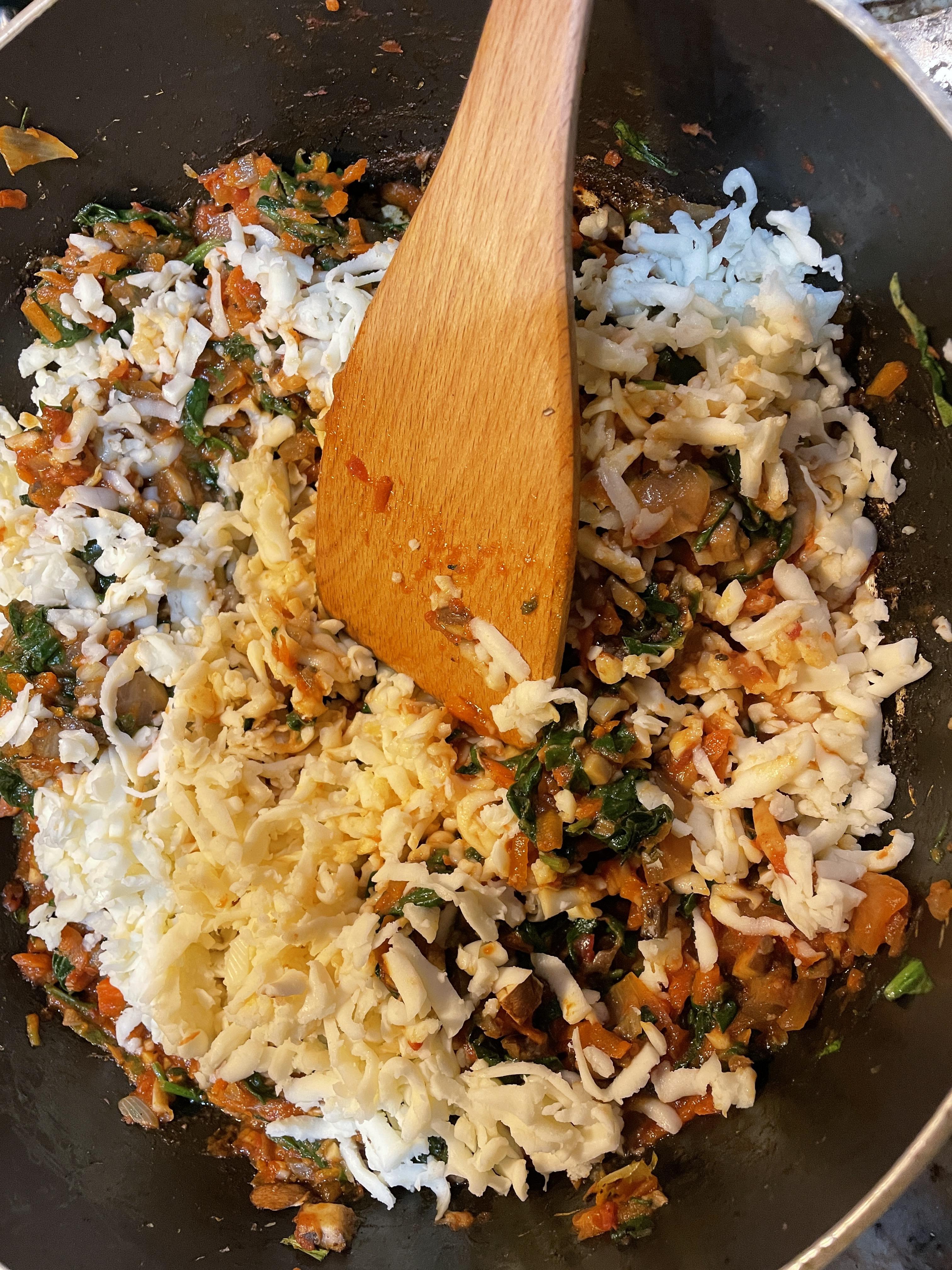 Add loads of mozzarella and parmesan
